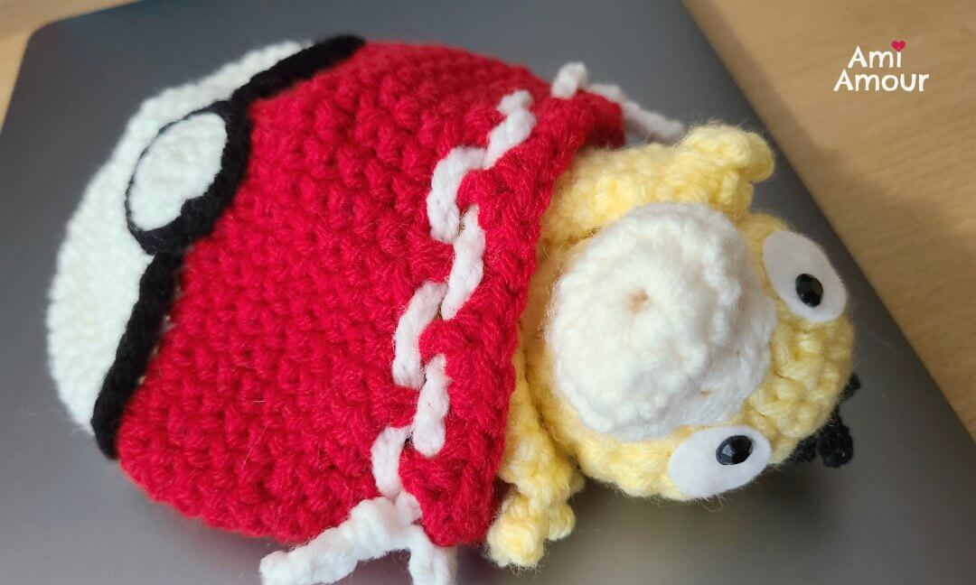 Psyduck sleeping in Pokeball Cozy