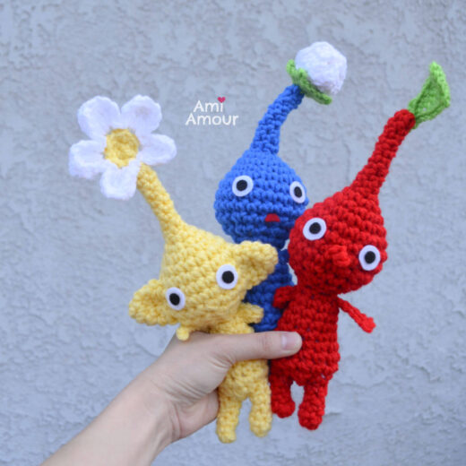 Pikmin Amigurumi in yellow, blue, and red